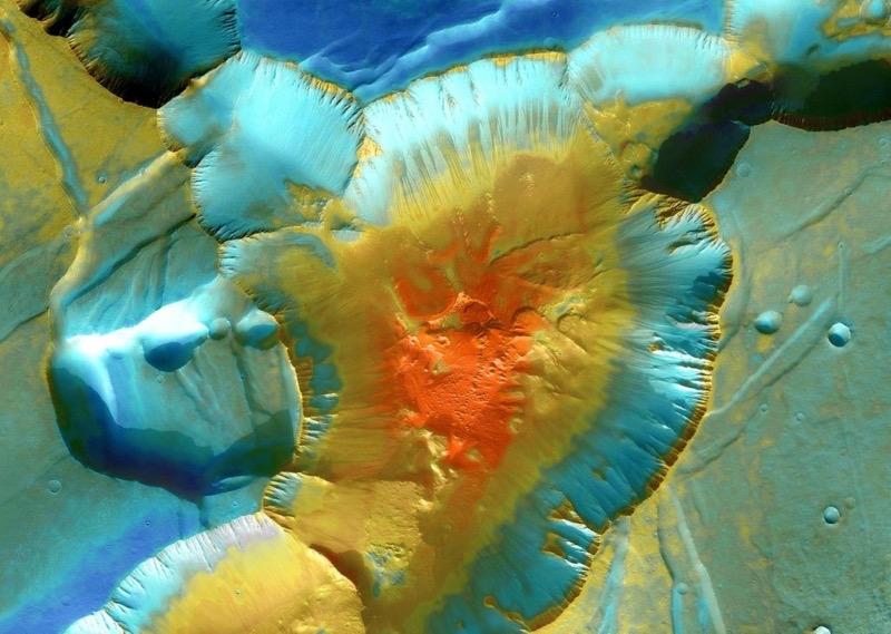 An dieser Stelle in Noctis Labyrinthus, dem Ausläufer eines großen Grabenbruchsystems, münden mehrere Canyons und bilden eine vier Kilometer tiefe Mulde. (Foto: NASA/JPL-Caltech/University of Arizona)
