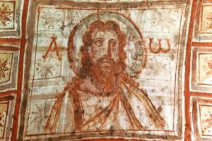 "Rom_–_Roma_(Italien),_Commodilla-Katakomben_–_Catacombe_di_Commodilla_Decke.__""Christus""_(Zwischen_Alpha_und_Omega).__Frühchristlich,_Mitte_4._Jahrhundert._Wandmalerei,_60_×_72_cm."